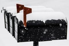 Drie Sneeuw Zwarte Brievenbussen Stock Afbeeldingen
