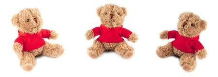 Drie speelgoed zachte die beren op witte achtergrond worden geïsoleerd Het concept van de kaartviering stock foto's