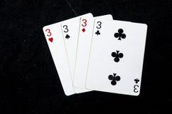 Drie speelkaarten allen gewaaid van de drie ` s stock fotografie