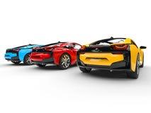 Drie sportwagens - primaire kleuren - achtermening Royalty-vrije Stock Afbeelding
