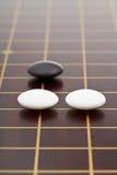 Drie stenen tijdens gaan spel het spelen Royalty-vrije Stock Foto's