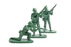 Drie stuk speelgoed militairen royalty-vrije stock foto