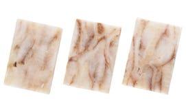 Drie stukken van bevroren gedrukt pollock geïsoleerd op witte backgro royalty-vrije stock foto's