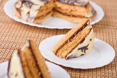 Drie stukken van cake op drie Royalty-vrije Stock Afbeeldingen