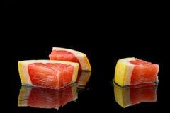 Drie stukken van grapefruit Stock Fotografie