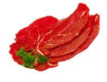 Drie stukken van rundvlees met een twijg van peterselie Royalty-vrije Stock Fotografie