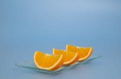 Drie stukken van verse sinaasappel royalty-vrije stock afbeelding