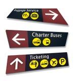 Drie Tekens van de Richting van de Luchthaven bij Gekke Hoeken Stock Afbeeldingen