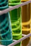 Drie test-buizen met vloeistoffen in een tribune Royalty-vrije Stock Afbeelding