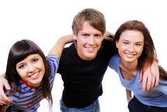 Drie tieners die hoofden houden Royalty-vrije Stock Afbeeldingen