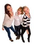 Drie trendy vrouwelijke vrienden stock foto's