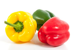 Drie tricolorpaprika Stock Afbeelding