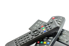 Drie TV-Afstandsbedieningen over witte achtergrond Stock Fotografie