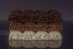 Drie types van chocolade royalty-vrije stock afbeelding