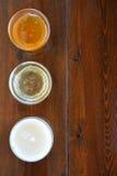 Drie types van honing Stock Foto's