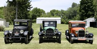 Drie Uitstekende Auto's Stock Foto
