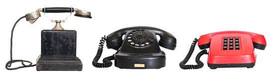 Drie uitstekende geïsoleerder telefoons Stock Foto's