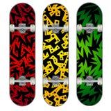 Drie vectorskateboard kleurrijke ontwerpen Stock Foto