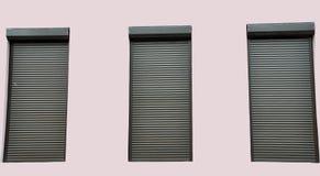 Drie vensters met gesloten jaloezie Stock Foto's