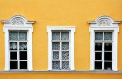 Drie vensters met gordijnen Stock Afbeeldingen