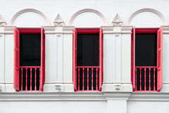 Drie vensters met rode open blinden royalty-vrije stock foto