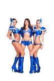 Drie verleidelijke dansers in blauwe clubkostuums Stock Afbeeldingen