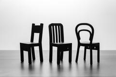 Drie verschillende stijlen van stoel in zwart-wit Stock Fotografie