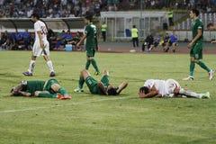 Drie verwonde spelers Stock Foto