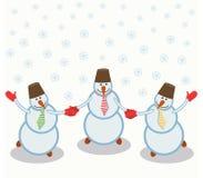 Drie vrolijke sneeuwmannen Stock Fotografie