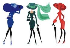Drie vrouwen in hoeden Stock Afbeelding