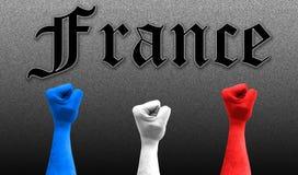Drie vuisten in de lucht met de kleuren van de vlag van Frankrijk stock foto