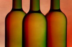 Drie wijnflessen Stock Foto's