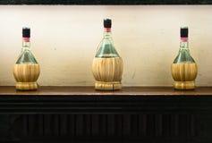 Drie wijnflessen Stock Afbeelding