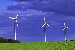 Drie windturbines Stock Afbeeldingen