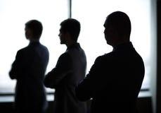 Drie zakenlieden in het bureau Stock Foto's