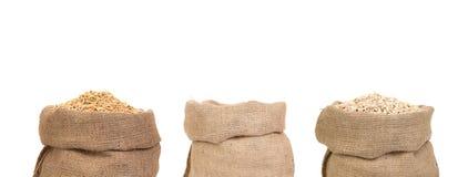 Drie zakken graangewassen Stock Afbeelding