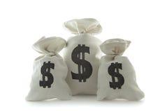 Drie zakken met geld Stock Foto's