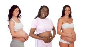 Drie zwanger vrouwenwachten Stock Afbeeldingen