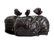 Drie zwarte vuilniszakken Stock Foto's