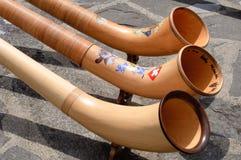 Drie Zwitserse Alphorns Stock Fotografie