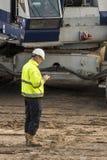 Construction Site Worker Cell Phone Driebergen Station. Driebergen, Netherlands - November 26, 2017: Construction site at the railway station in Driebergen Royalty Free Stock Photos