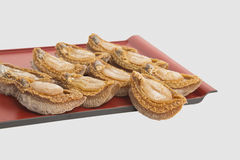 Dried abalone on bamboo tray in white background Royalty Free Stock Photography