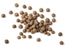 Dried allspice isolated on white background, top view. Dried allspice isolated on the white background stock image