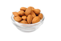Dried almonds on glass bowl Royalty Free Stock Images