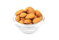 Dried almonds on glass bowl Royalty Free Stock Photos