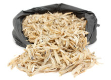 Dried anchovies over white Royalty Free Stock Photos