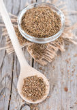 Dried Aniseed on a wooden spoon Royalty Free Stock Photos