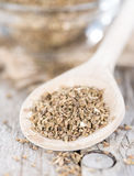 Dried Aniseed on a wooden spoon Stock Photo