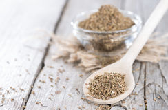 Dried Aniseed on a wooden spoon Stock Images