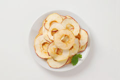 Dried apple chips. Plate of dried apple chips on white background - close up Stock Photo
